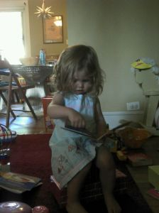 Big girl reading all by herself